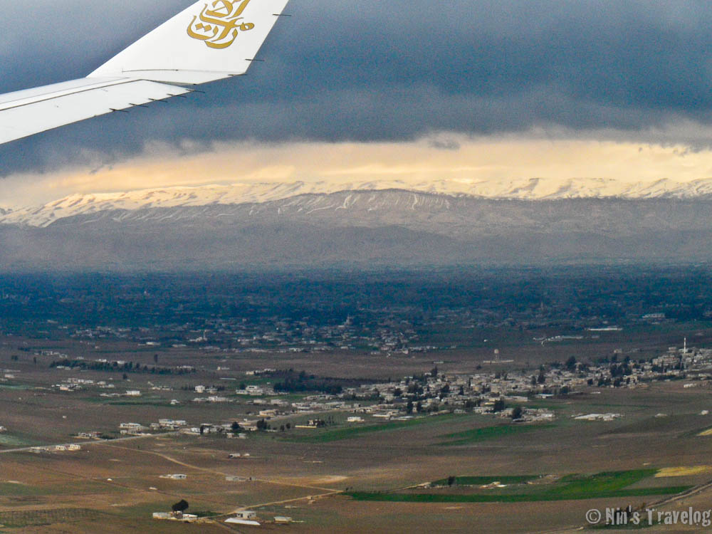 Above Syria, with snowy mountain surounding it