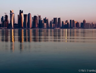 Reflection of the sun on a very calm corniche water