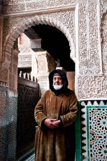 A portrait of holly man inside a madrasa
