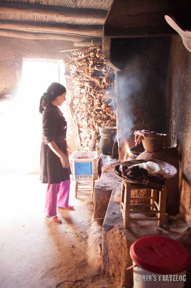Preparing the Moroccan Bread while they allow us to explore their house.