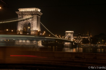 Chain Bridge as the back ground when the yellow city car just passed by.