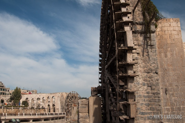 Hama Water Wheel - The City of Hama, famous for it's water wheel on the river Orontes, built in the 7th century. One of the largest had a diameter of about 20 metres and its rim was divided into 120 compartments. The picture shows one of the 17 water wheels survived to the 21st century. What I don't know is whether this is surviving the civil war.