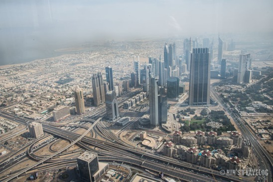 "View ""at the top"" or from level 124 of Burj Khalifa on a hazy morning and a bit under develop?"