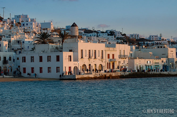 An hour before sunset at Mykonos, where the sunlight touches the white painted buildings and created a warm colour on the buildig