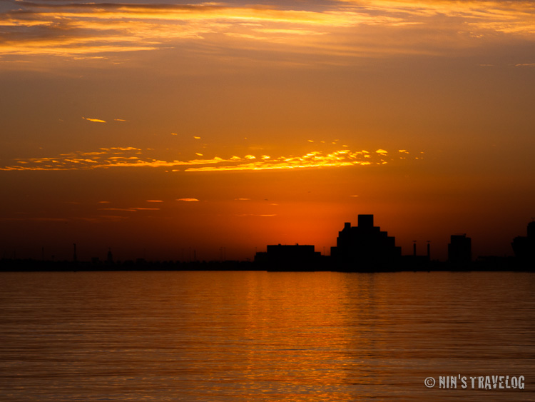 Sunrise in Doha, where the sun was just behind that building... or this is only a few seconds before sunrise?