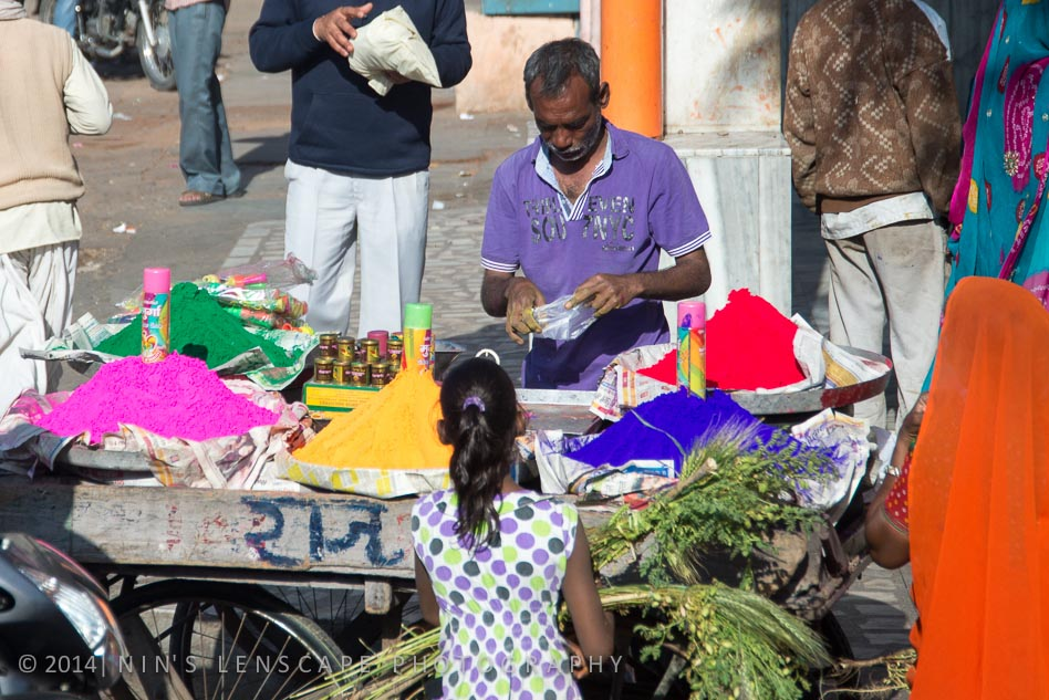 People in the market in Jaipur selling the colour powder....