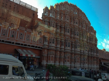 Jaipur the Rose City - The facade of the rose city as taken from inside our bus, hence the reflection of the bus window