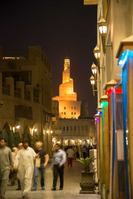 Al Fanar Mosque or more popular among the English society as Cock-screw mosque - an old iconic building of Doha as the background of the souk